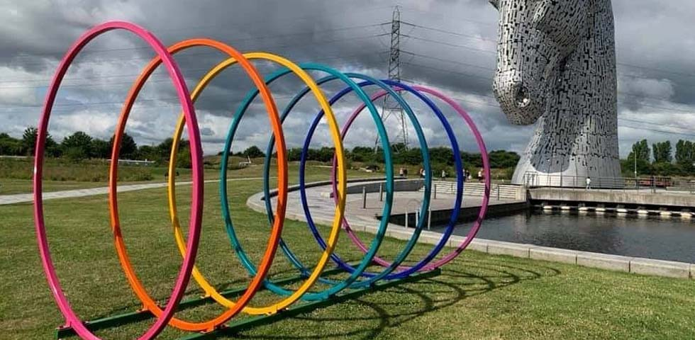 A vibrant sculpture bent by Barnshaws Scotland decorates the Scottish Canal landscape first image