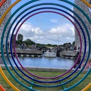 A vibrant sculpture bent by Barnshaws Scotland decorates the Scottish Canal landscape.