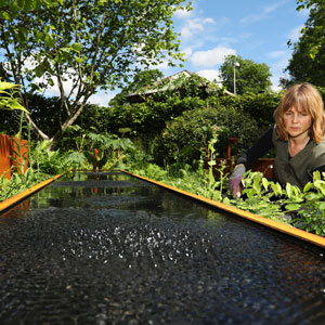 Royal Horticultural Society planting team member Stephanie Marling puts the finishing touches to the Zoe Ball Listening Garden